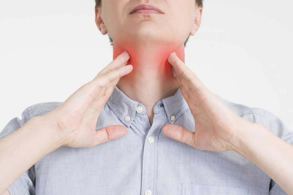 Sore throat, men with pain in neck, gray background